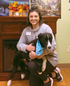 Kelsey Fulton who is now the Activities Director and her dog Cash.